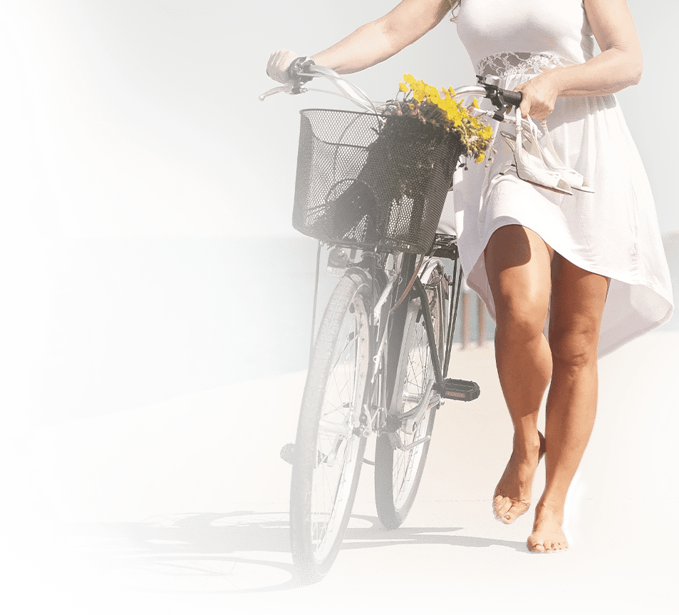 Woman walking her bike